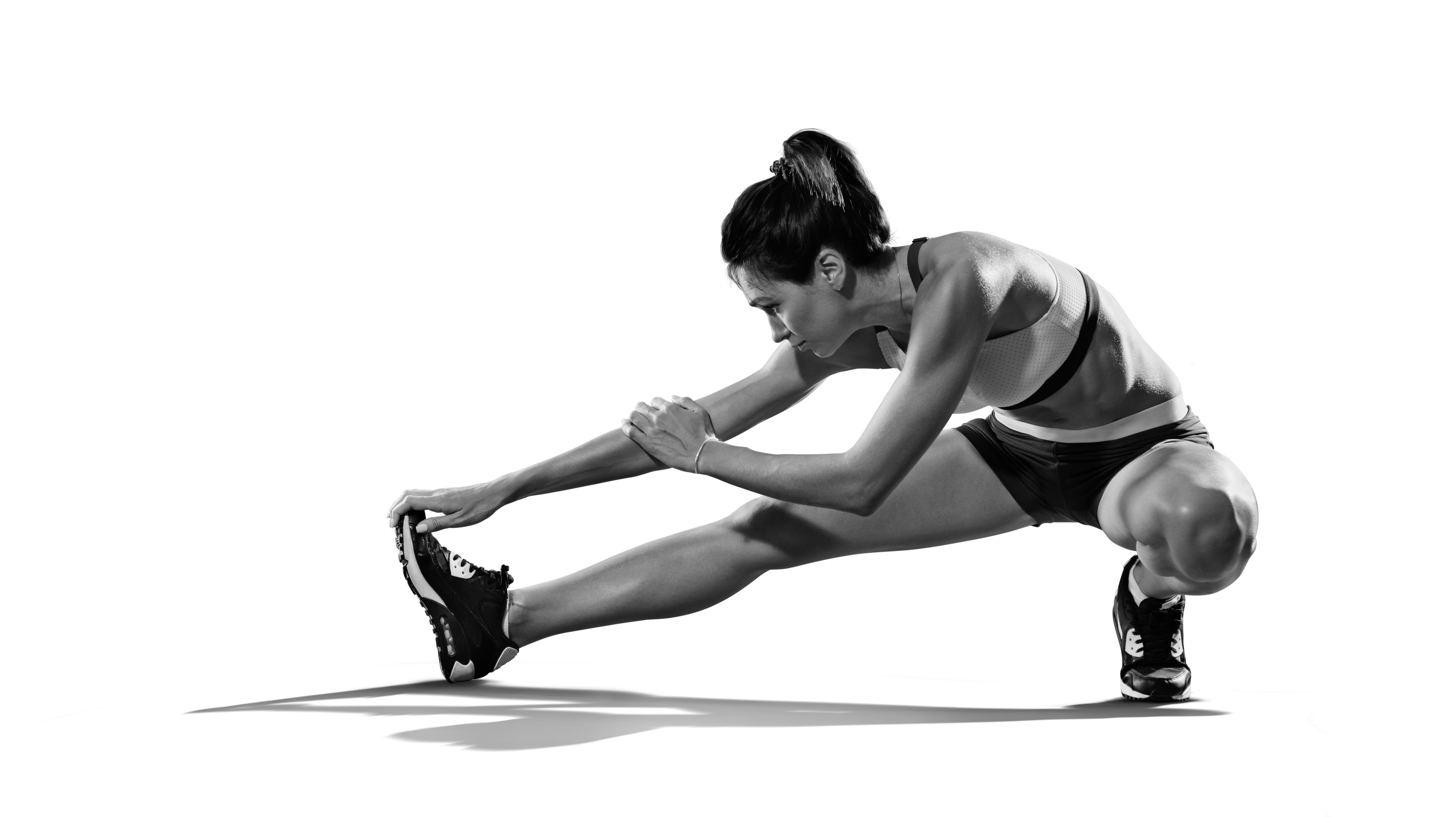 Sports.,Woman,At,The,Gym,Doing,Stretching,Exercises,And,Smiling